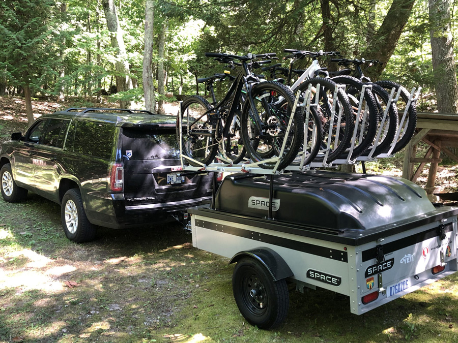 silver space trailer loaded with bikes