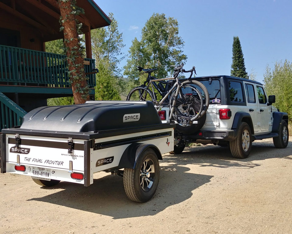 Silver Space Trailer With Jeep