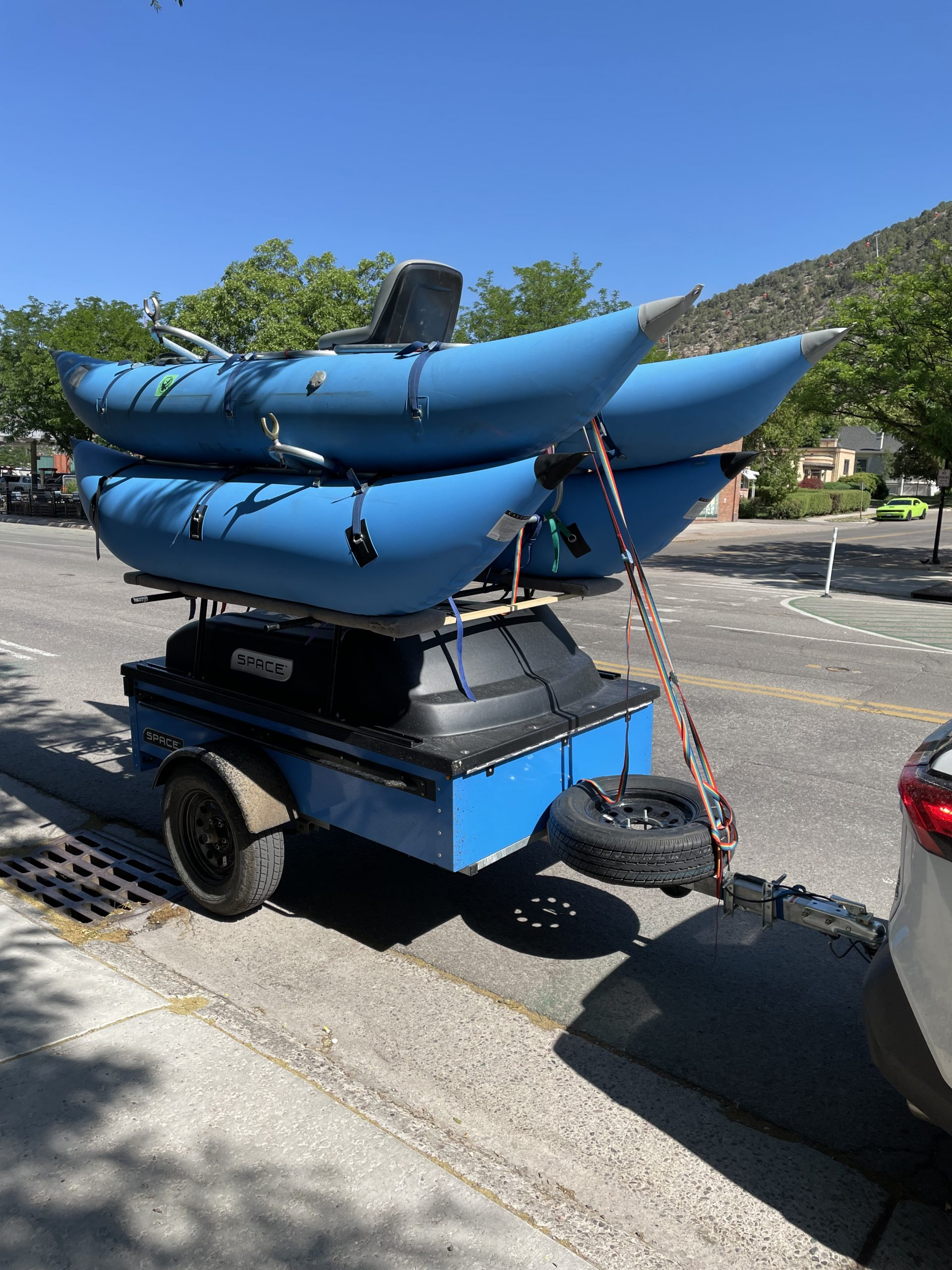 Blue Trailer with blue river rafts